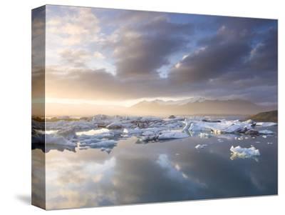 Icebergs Floating on the Jokulsarlon Glacial Lagoon at Sunset, Iceland, Polar Regions