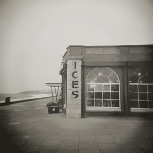 Ices Sign on Side of Old Rendezvous Cafe on Dull Winter's Day, Whitley Bay, Tyne and Wear, England by Lee Frost