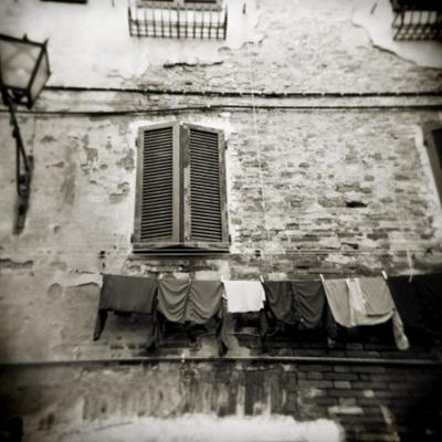 Laundry Hanging from Wall of Old Building, Siena, Tuscany, Italy by Lee Frost