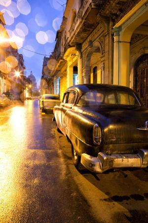 Low Light View Along a Street Towards the Capitolio with Street Lights Reflecting in the Wet Tarmac
