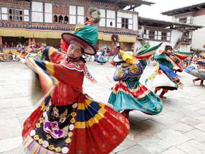Monks Performing Traditional Black Hat Dance at the Wangdue Phodrang Tsechu, Wangdue Phodrang Dzong by Lee Frost