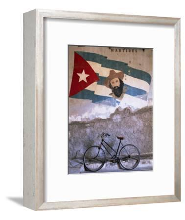 Mural of Camilo Cienfuergos on Wall Above a Bicycle, Havana, Cuba, West Indies, Central America