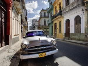 Old American Plymouth Car Parked on Deserted Street of Old Buildings, Havana Centro, Cuba by Lee Frost