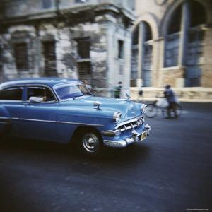 Panned Shot of an Old Blue American Car, Havana, Cuba, West Indies, Central America by Lee Frost