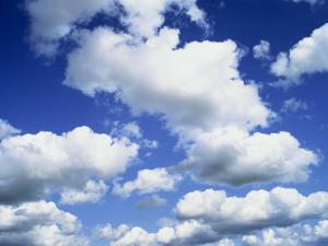 Puffy White Clouds in a Blue Sky in England, United Kingdom, Europe by Lee Frost