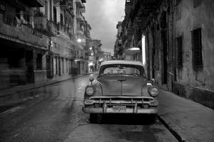 Red Vintage American Car Parked on a Floodlit Street in Havana Centro at Night by Lee Frost