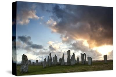 Standing Stones of Callanish at Sunset with Dramatic Sky in the Background