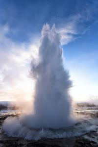 Strokkur Geysir Erupting at Sunrise on a Freezing Winter's Morning Against the Colourful Sky by Lee Frost