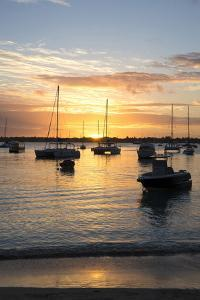 Sunset over the Indian Ocean with Boats in Silhouette on the Calm Water Off the Beach at Gran Baie by Lee Frost
