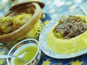 Traditional Food of Chicken Tagine, and Lamb with Cous Cous, Marrakech, Morocco by Lee Frost