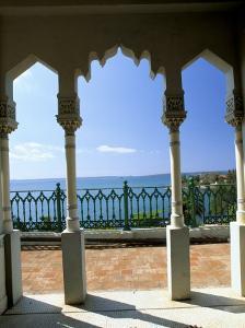 View to Sea Through Moorish Arches at Palacio De Valle, Cienfuegos, Cuba, West Indies by Lee Frost