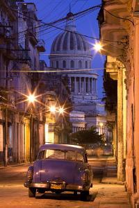 Vintage American Car Parked on Floodlit Street with the Capitolio in the Background by Lee Frost
