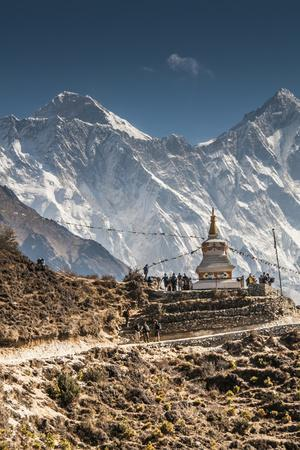 Trail through Khumbu Valley with Mt. Everest in background.