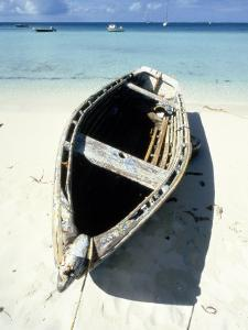 Wooden Row Boat Lying on Beach by Lee Peterson