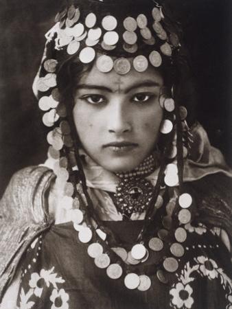 An Algerian Girl Wears a Dowry of Gold Coins by Lehnert & Landrock