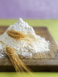 Flour and Wheat on Cutting Board by Leigh Beisch