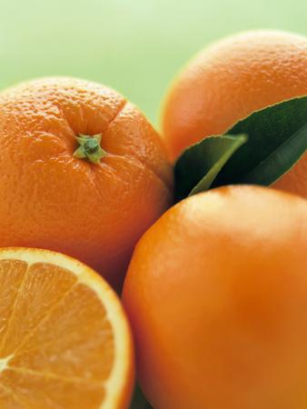 Oranges with Leaves Close Up