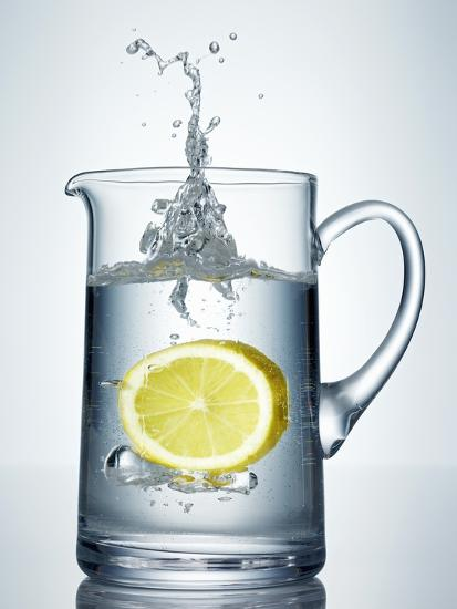 Lemon Falling into Jug of Water-Petr Gross-Photographic Print