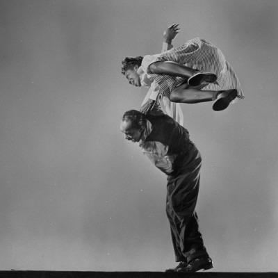 https://imgc.artprintimages.com/img/print/leon-james-and-willa-mae-ricker-demonstrating-a-step-of-the-lindy-hop_u-l-pa108j0.jpg?p=0