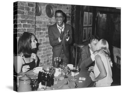 Actors Sammy Davis Jr. and Richard Burton and May Britt