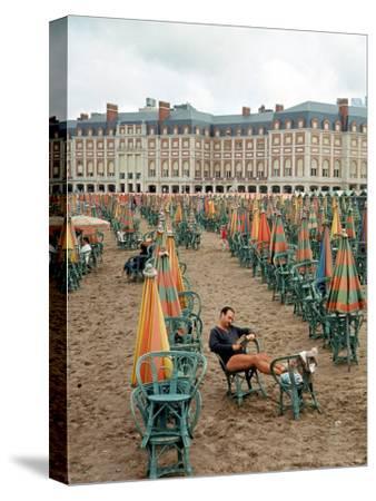 Folded Umbrellas Reflect Nearly Deserted Status of Mar Del Plata Beach