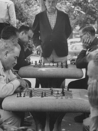 Men Playing Chess in Central Park by Leonard Mccombe