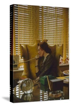 """Miss Evyan """"Baroness Langer Von Langendorff"""" Sitting at Her Desk, New York, NY, 1956"""