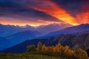 Fantastic Red Sunbeams with Overcast Sky at the Foot of Mt. Ushba. Dramatic Morning Scene. Location by Leonid Tit