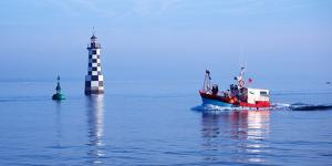 Les Perdrix Lighthouse and Fishing Boat at Loctudy, Brittany, France