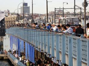 Fishermen Standing on the Galata Bridge, Istanbul, Turkey, Europe by Levy Yadid