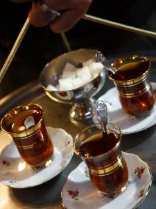 Hand Holding a Tray with Turkish Tea, Istanbul, Turkey, Europe by Levy Yadid