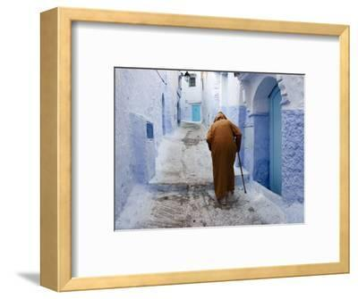Old Man Walking in a Typical Street in Chefchaouen, Rif Mountains Region, Morocco