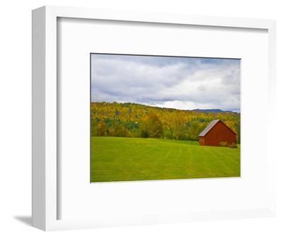Red Barn in Green Field in Autumn