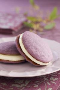 Two Lavender Whoopie Pies on a Plate by Lew Robertson
