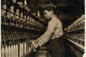 A Doffer Replaces Full Bobbins at Globe Cotton Mill, Augusta, Georgia, 1909 by Lewis Wickes Hine