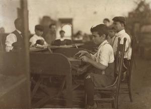 Child Apprentice at De Pedro Casellas Cigar Factory, Tampa, Florida, 1909 by Lewis Wickes Hine