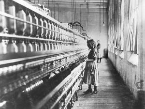 Girl at Spinning Machine by Lewis Wickes Hine