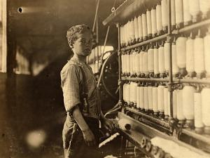 John Dempsey, 11 or 12 Years Old, Saturday Worker in the Mule-Spinning Room at Jackson Mill by Lewis Wickes Hine
