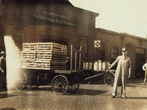 Men in Front of a Wells Fargo and Co Express Depot with Crates and Milk Cans, Missouri, 1916 by Lewis Wickes Hine