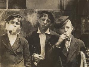 Three Young Newsboys Smoking, Saint Louis, Missouri, USA, circa 1910 by Lewis Wickes Hine
