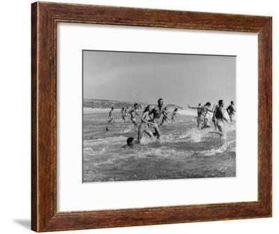 Lifeguards and Members of Womens Swimming Team Start Day by Charging into Surf-Peter Stackpole-Framed Premium Photographic Print
