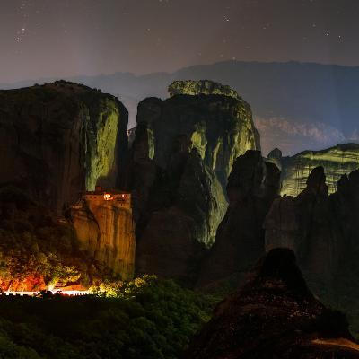 Light Shines on a Monastery Perched on a Sandstone Cliff-Babak Tafreshi-Photographic Print