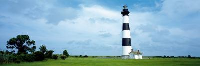 Lighthouse in a Field, Bodie Island Lighthouse, Bodie Island, North Carolina, USA--Photographic Print