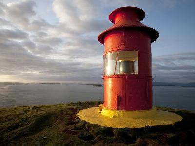 Lighthouse on Bluff Above Stykkisholmer, Iceland-Dave Bartruff-Photographic Print