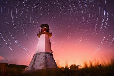 Lighthouse with Night Sky at Background Stars Trails- Q-lieb-in-Photographic Print