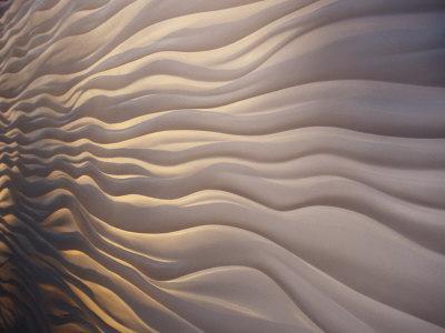 https://imgc.artprintimages.com/img/print/lighting-illiuminates-an-architectural-display-of-waves-in-a-wall_u-l-p8b7i40.jpg?p=0