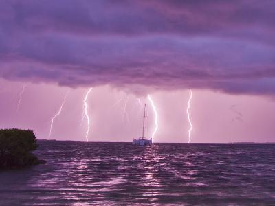 Lightning Bolts Striking the Ocean, and Almost Hitting a Sailboat-Mike Theiss-Photographic Print