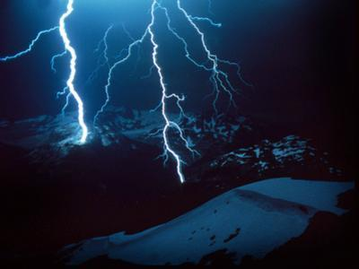 Lightning During a Storm over Snowy Mountains