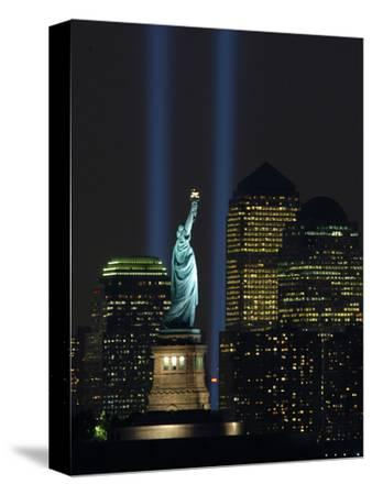 Lights from the Former World Trade Center Site Can be Seen on Both Sides of the Statue of Liberty