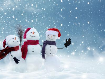 Merry Christmas and Happy New Year Greeting Card with Copy-Space.Many Snowmen Standing in Winter Ch